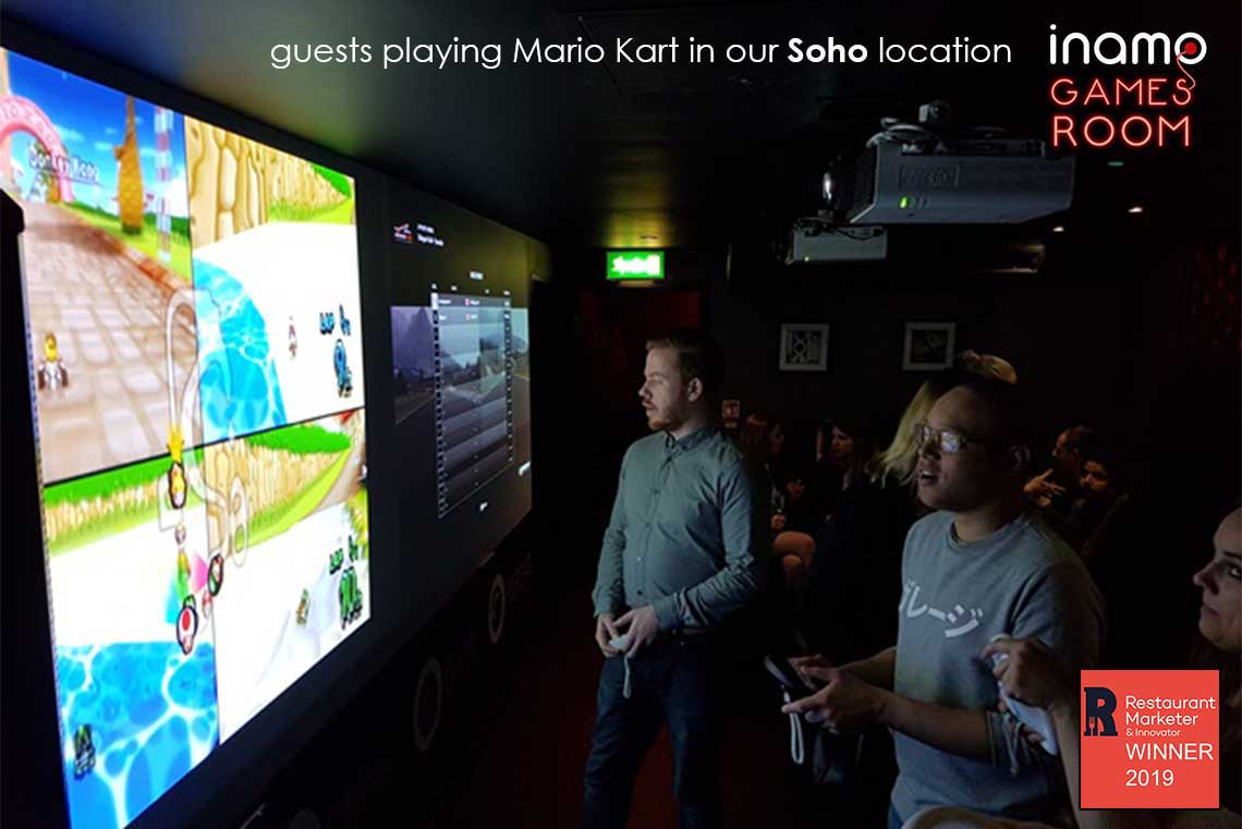 Playing Mario Kart in the Inamo Games Room
